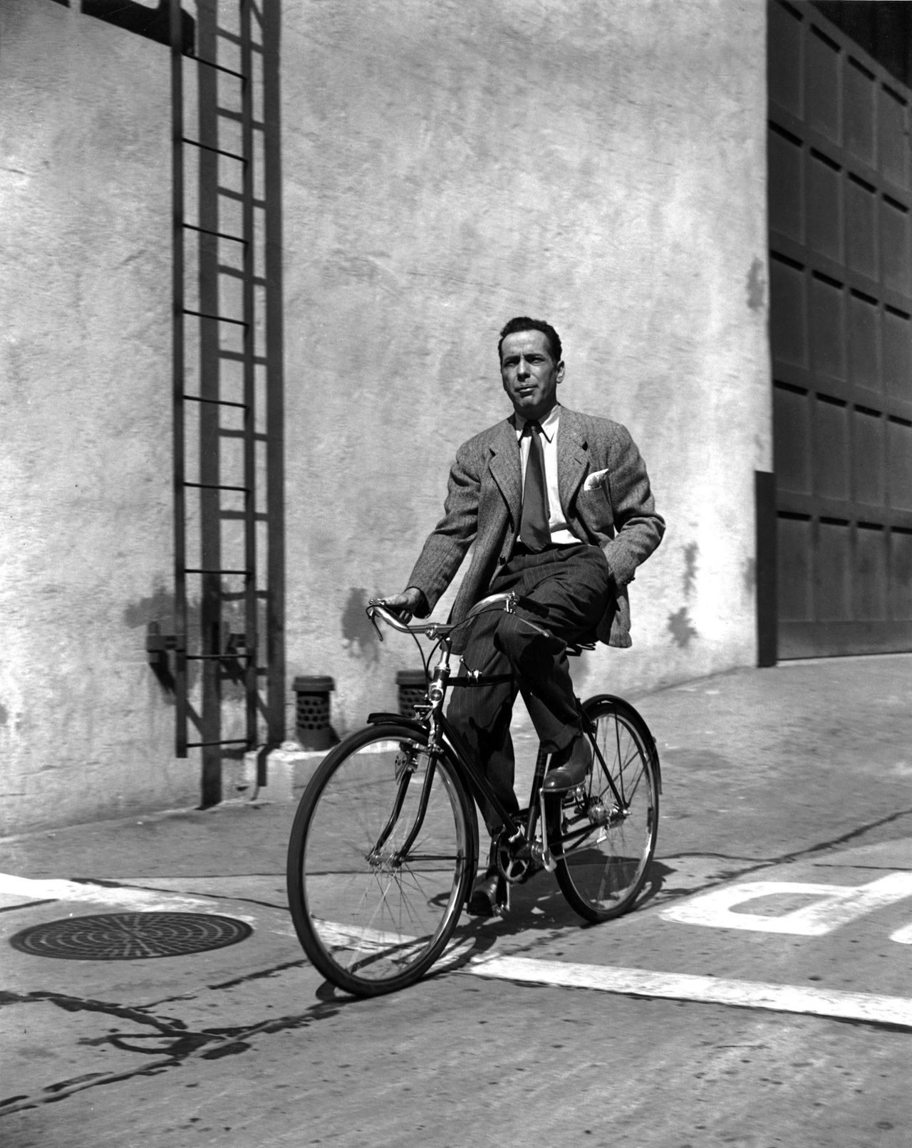 Humphrey Bogart on bicycle