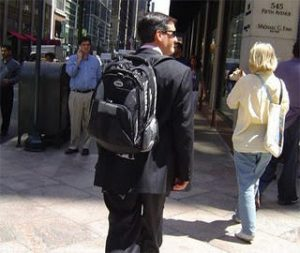 Wearing back pack with suit