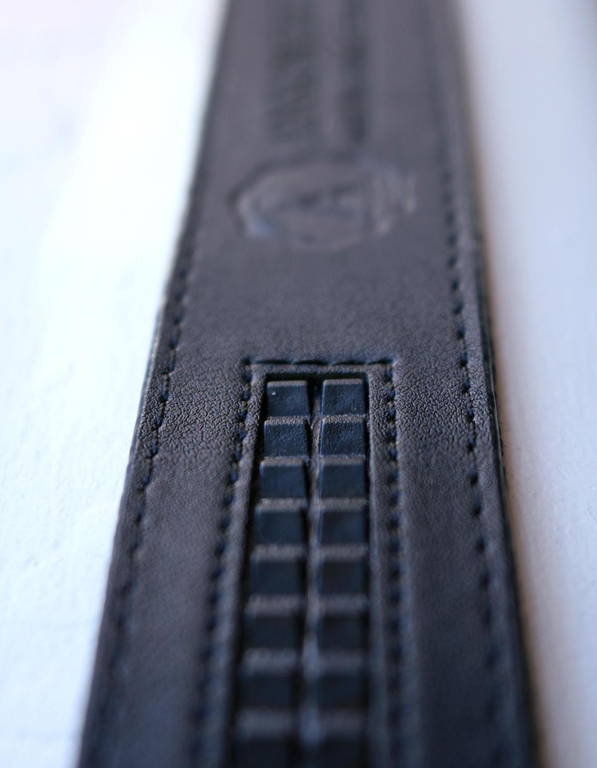 Slide belt track grooves