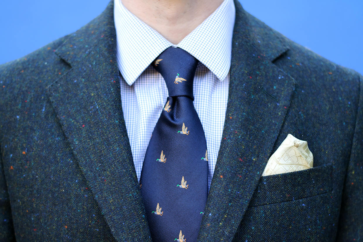 Green tweed jacket with navy silk tie