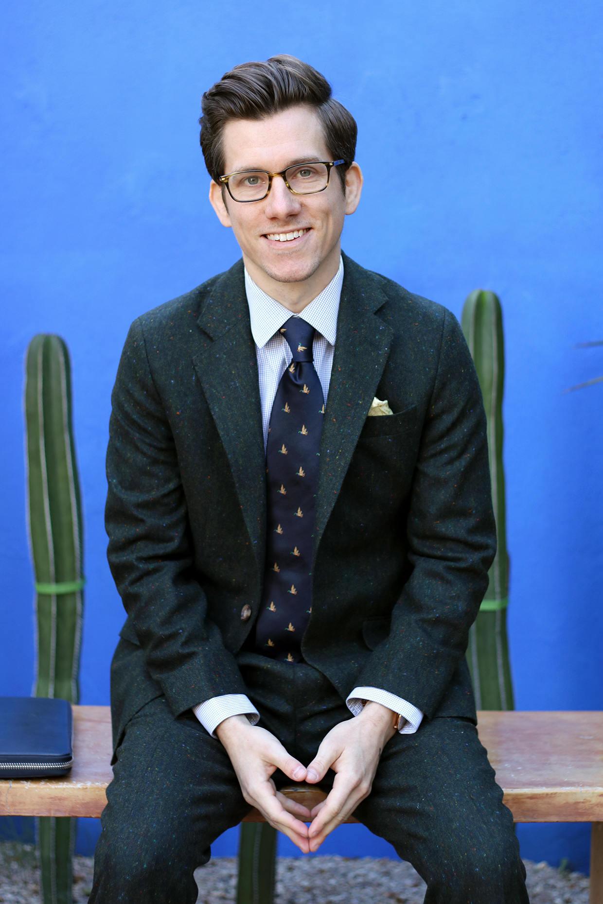 Green suit with navy tie