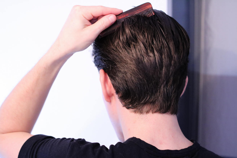 Combing back of head