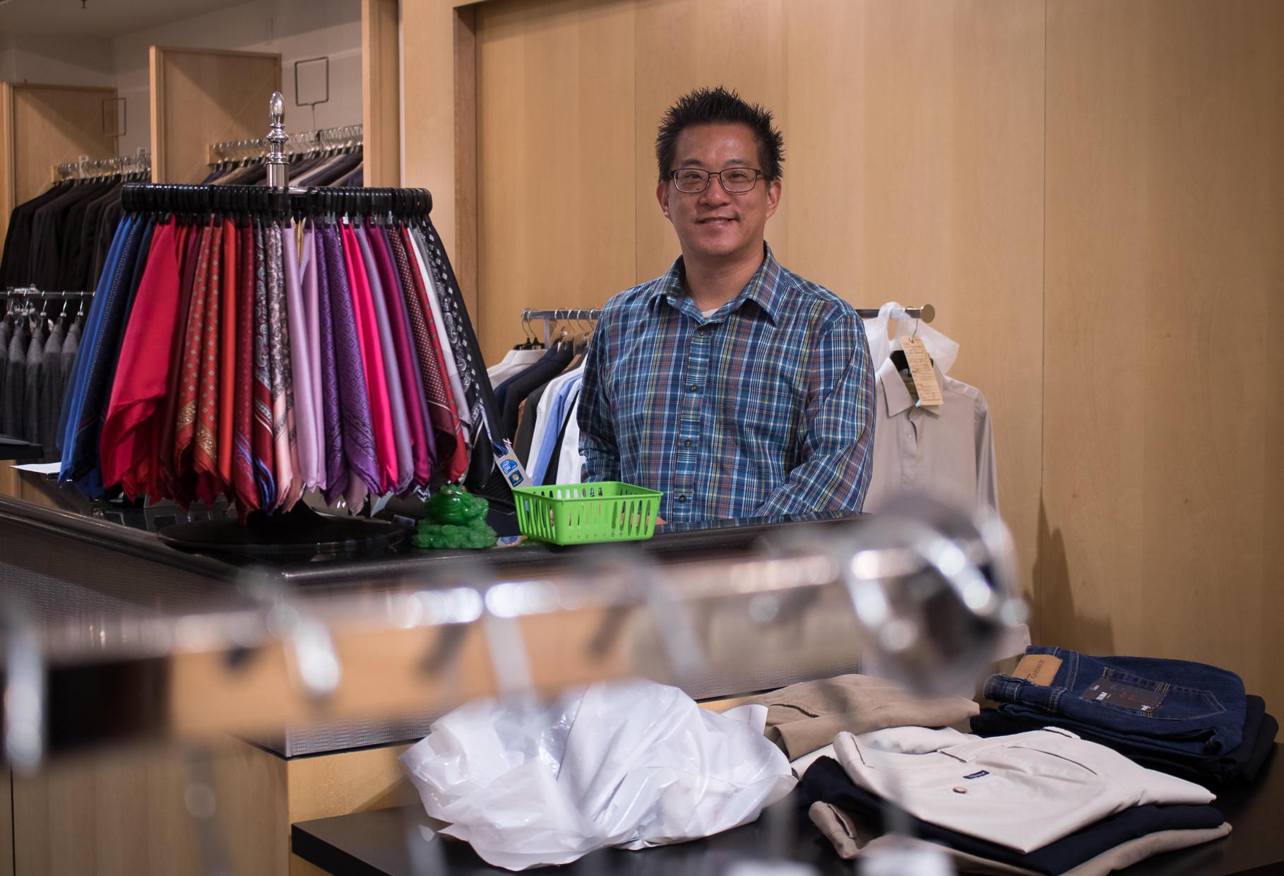 Alan Au at cash register
