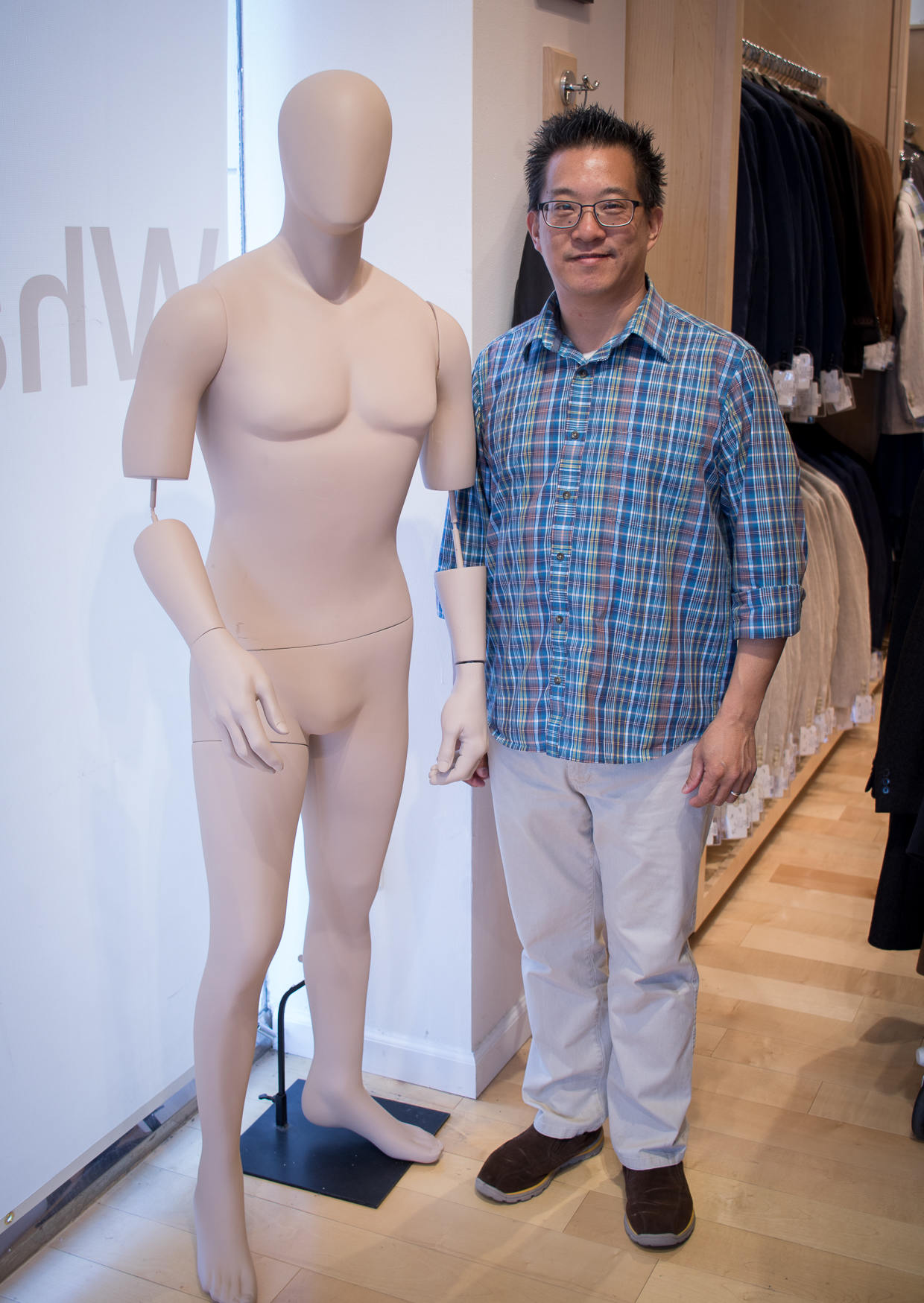 Alan Au next to mannequin