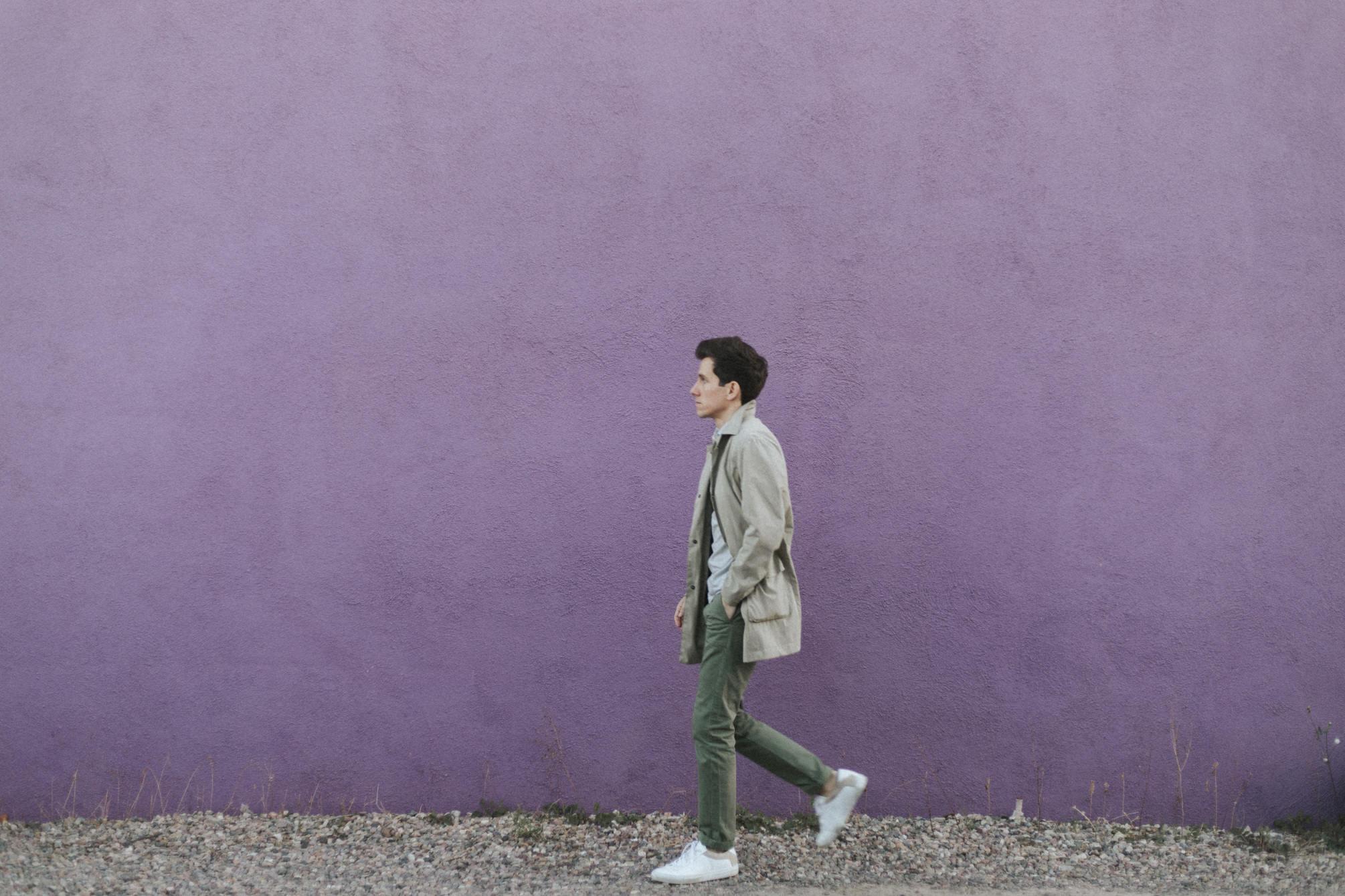 Walking in front of purple wall