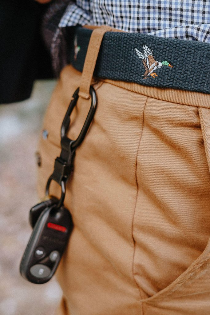 Embroidered belt with key clip