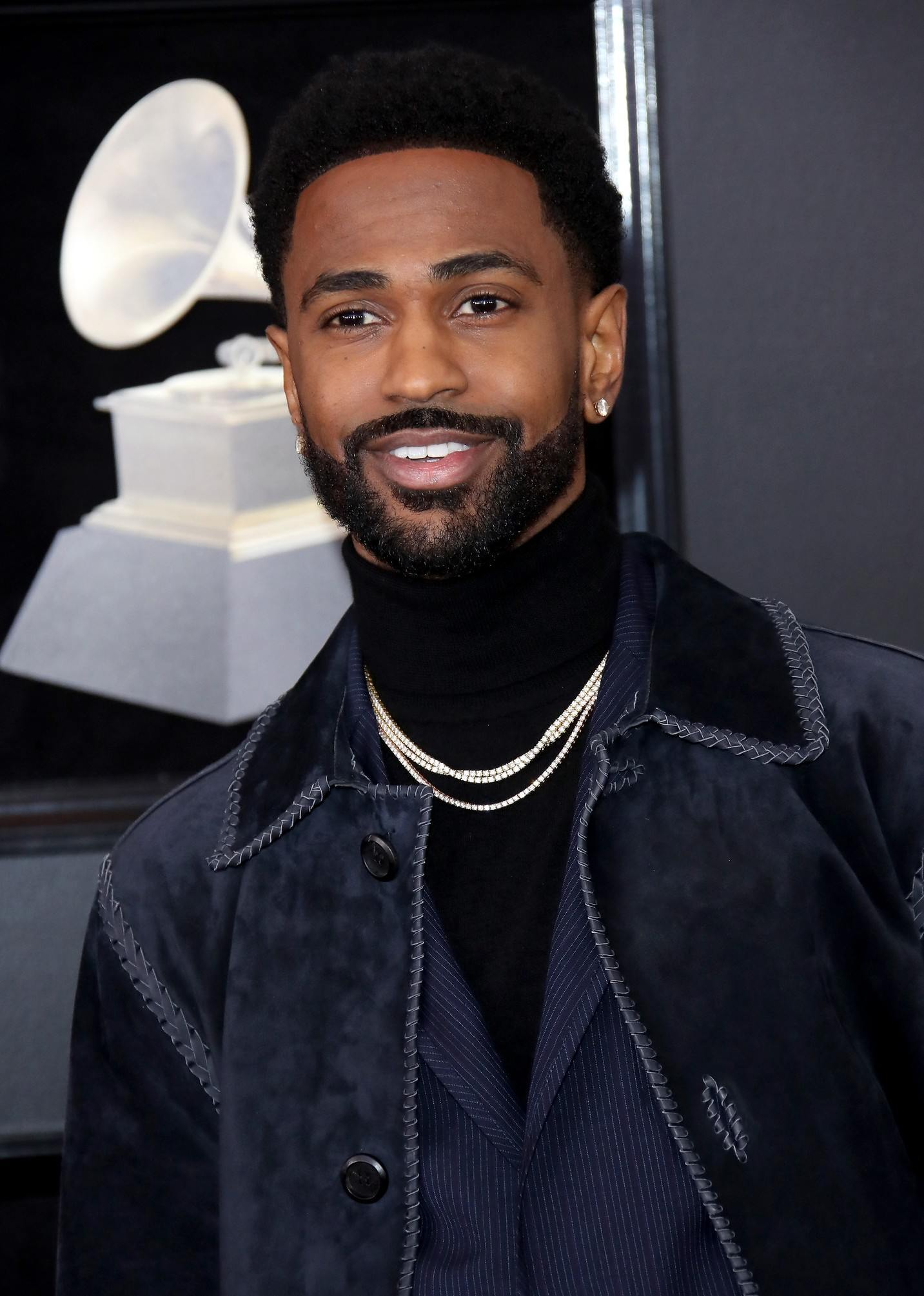 Big Sean wearing a velvet coat