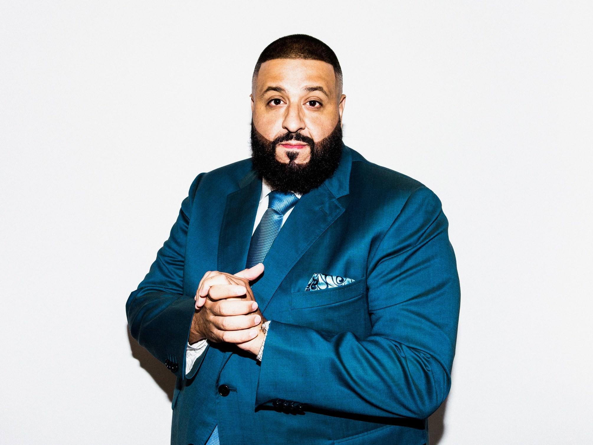 DJ Khaled wearing a blue suit