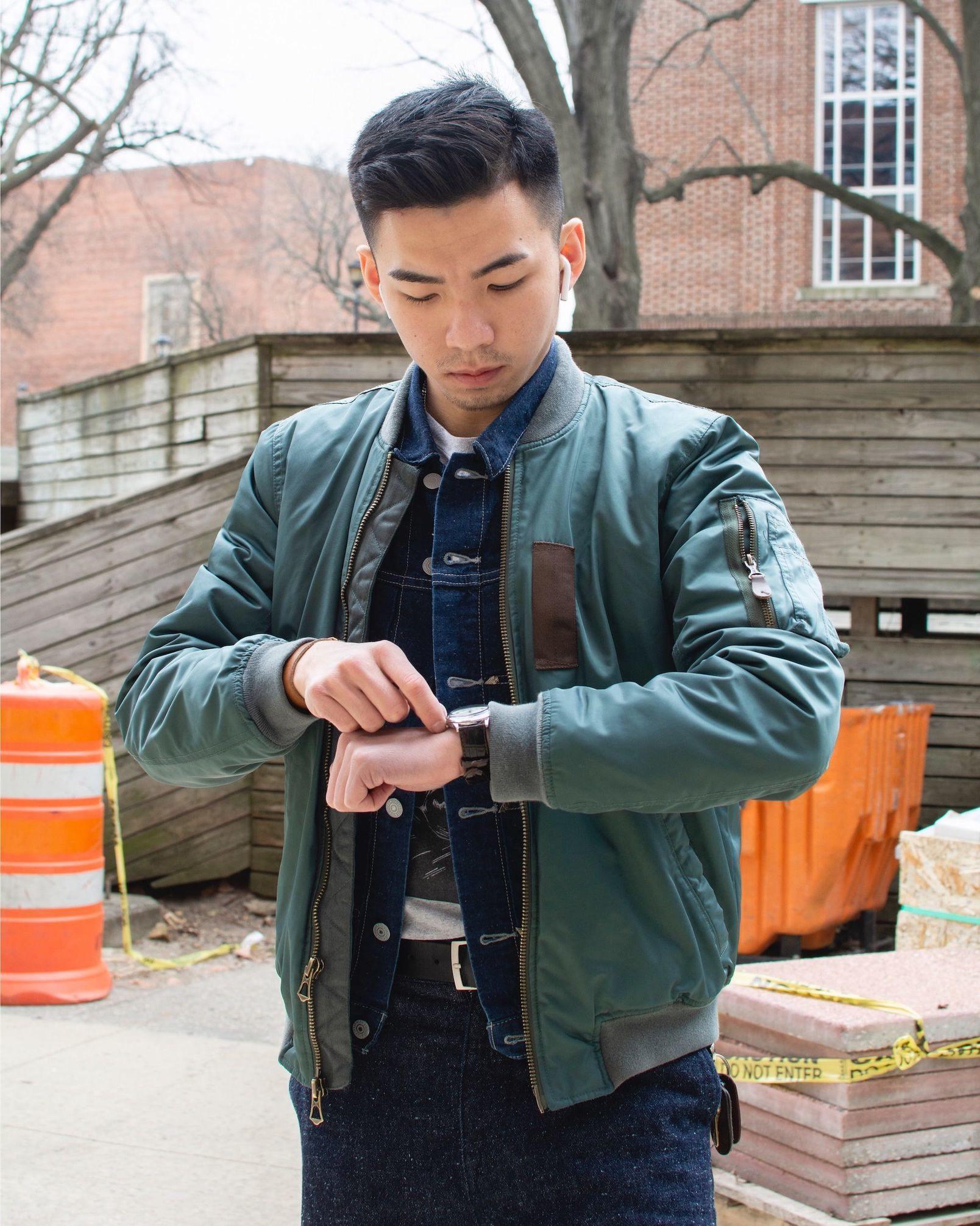 Humphrey Tsui checking his watch