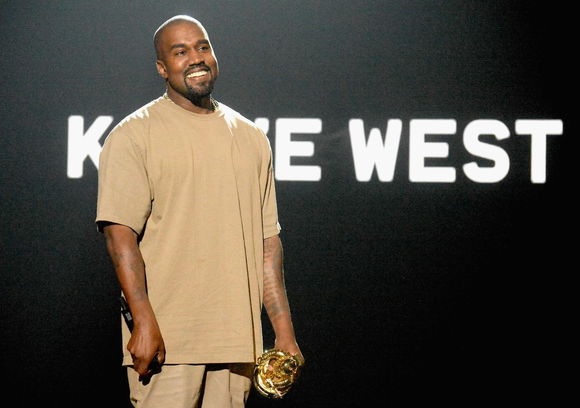 Kanye West wearing an all brown outfit