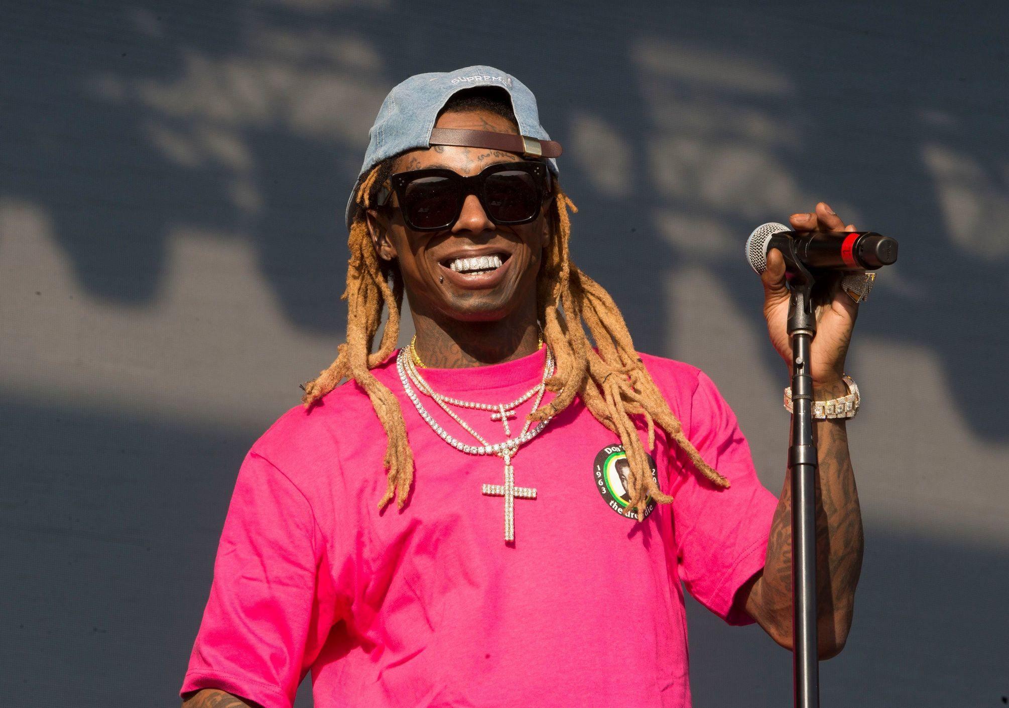 Lil Wayne wearing pink tshirt