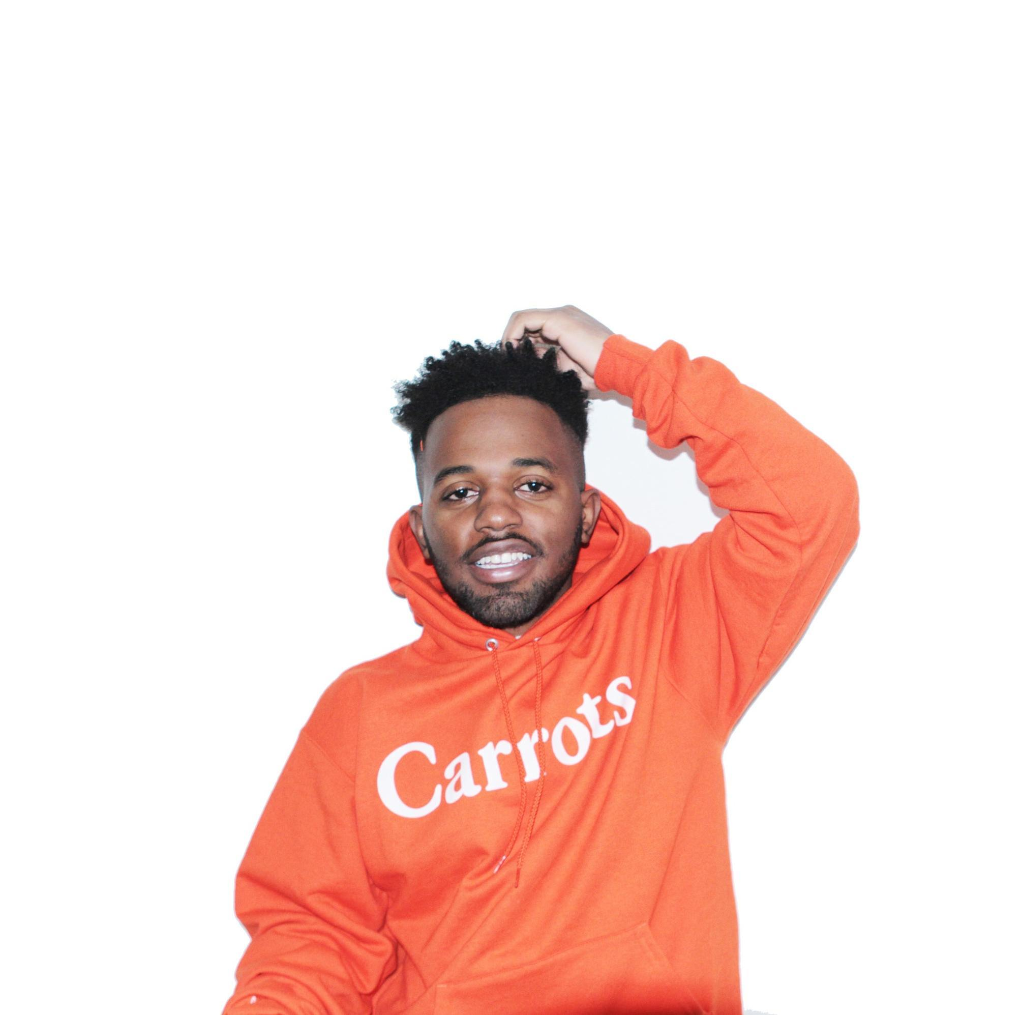 MadeinTYO wearing an orange hoody