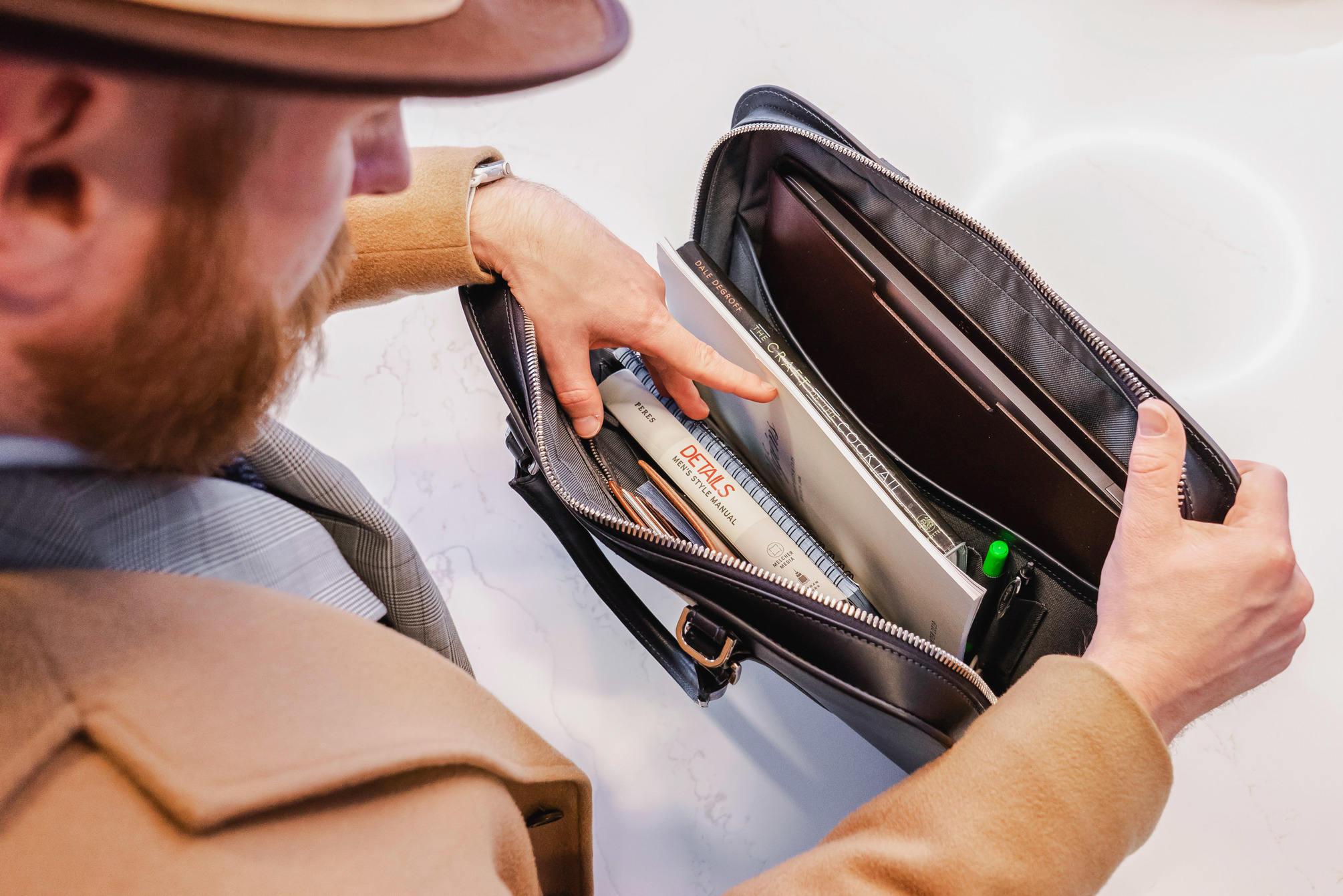 Looking through briefcase
