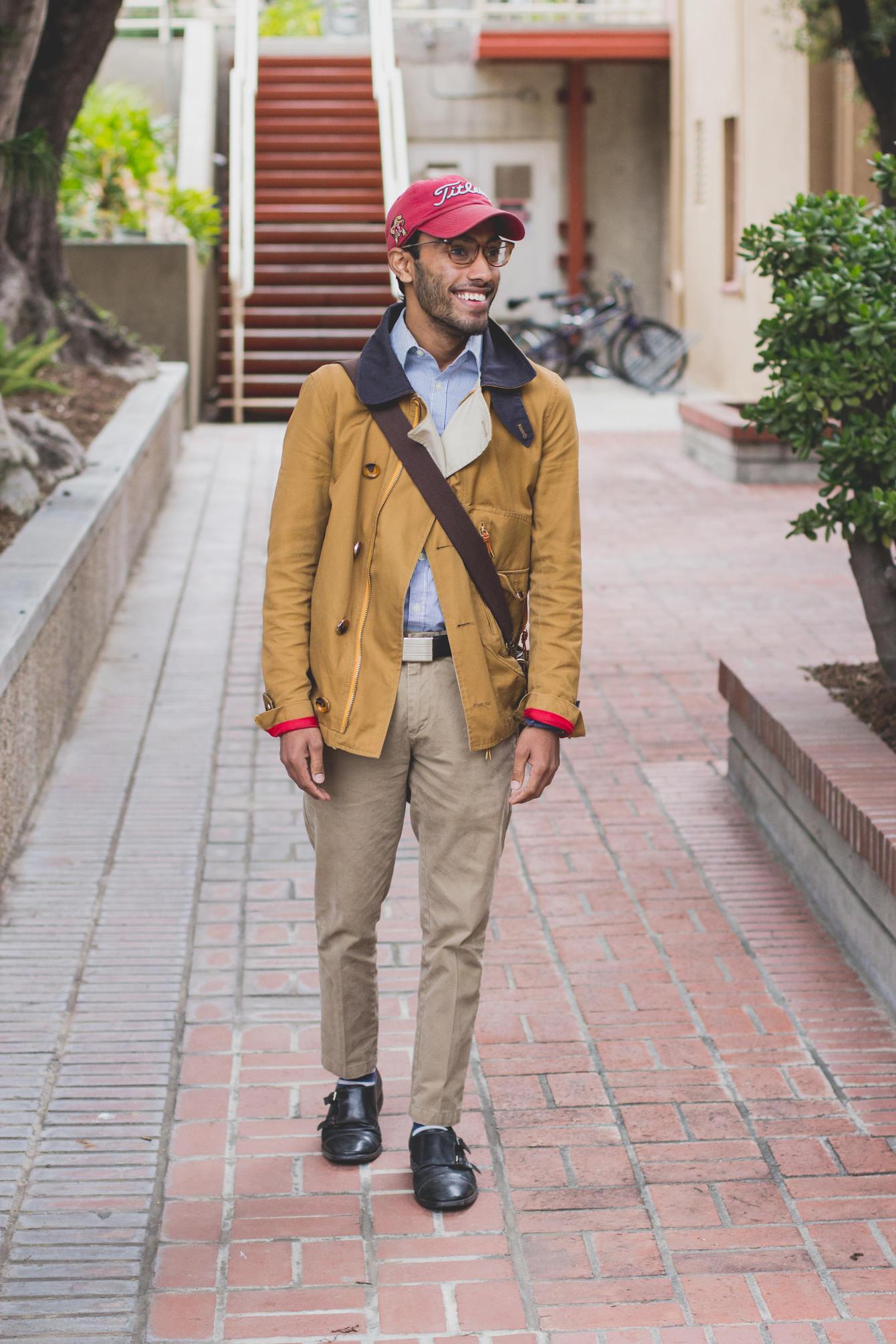 Rajesh wearing sky blue shirt, mustard yellow jacket and khaki pants