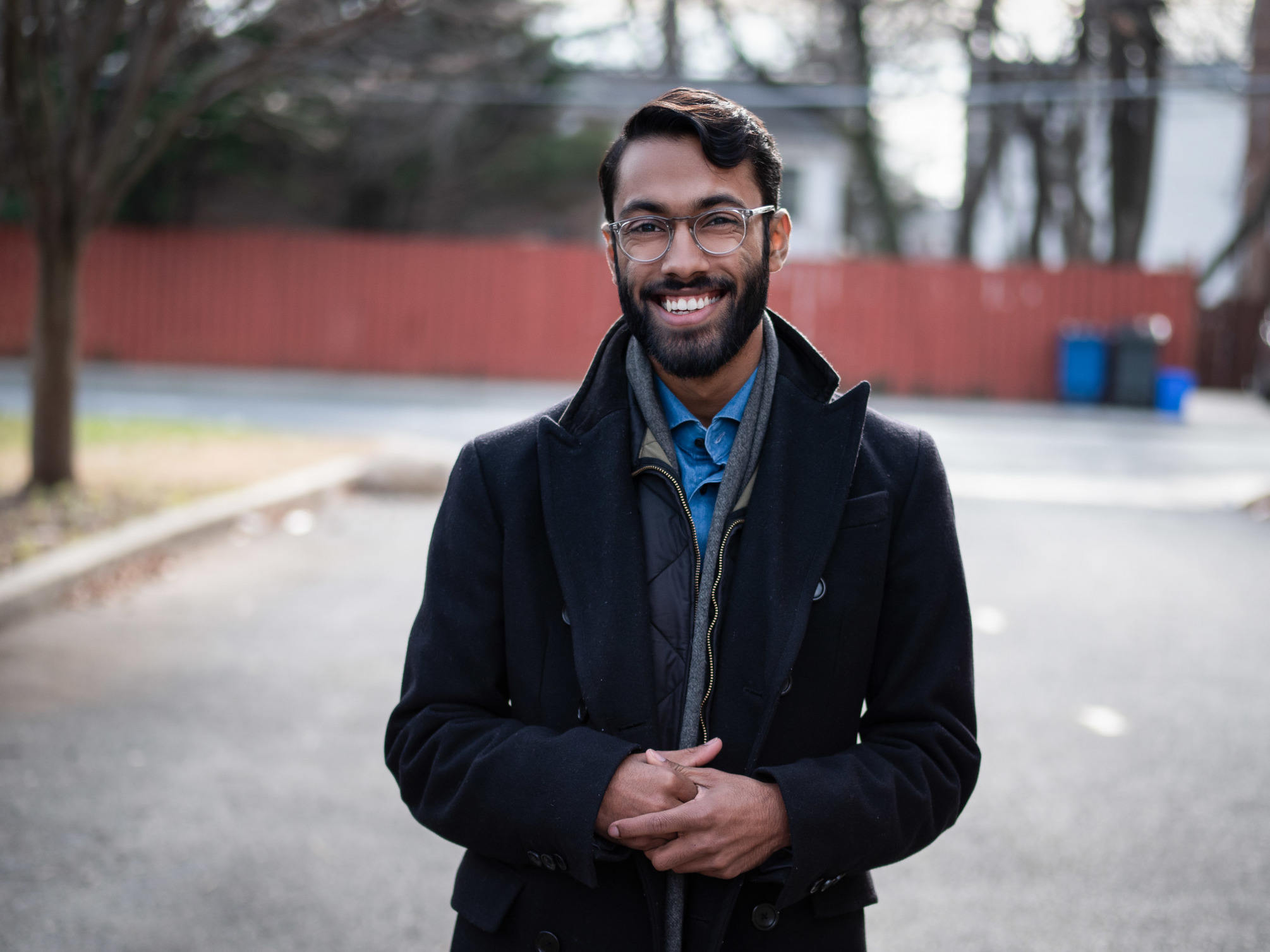 Rajesh wearing a wool topcoat