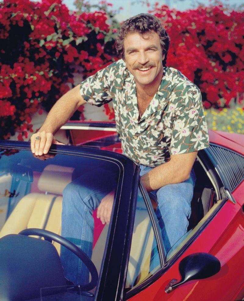 Tom Selleck wearing aloha shirt and jeans