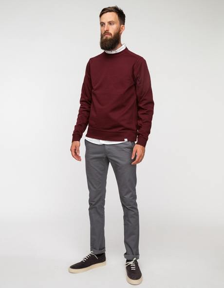 man wearing gray chinos and maroon shir