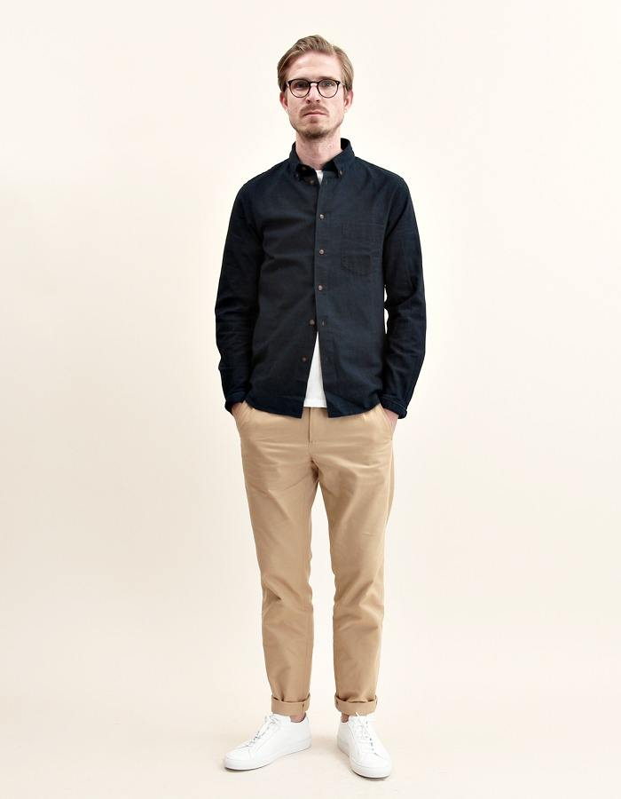 man wearing khaki chinos and black polo