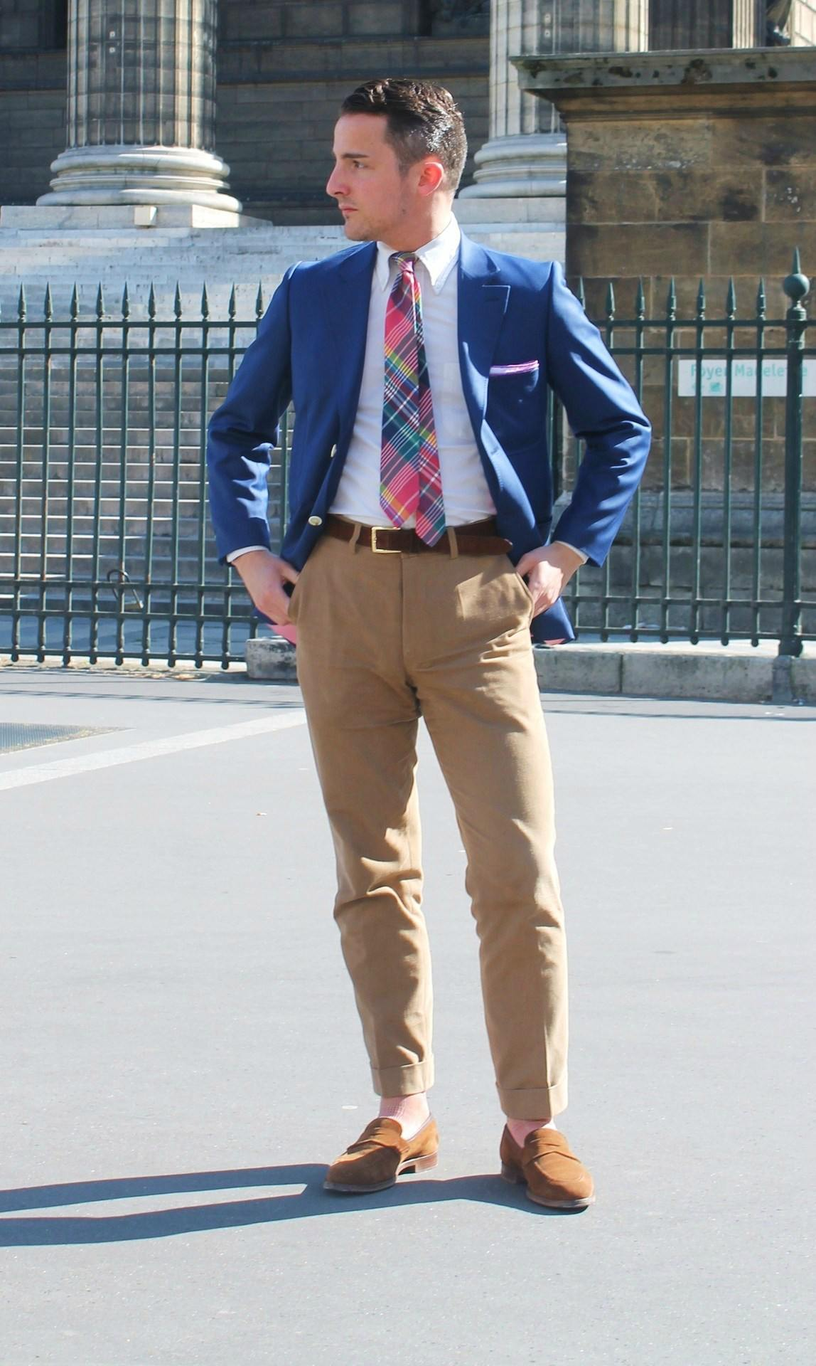 man wearing khaki chinos and colorful tie