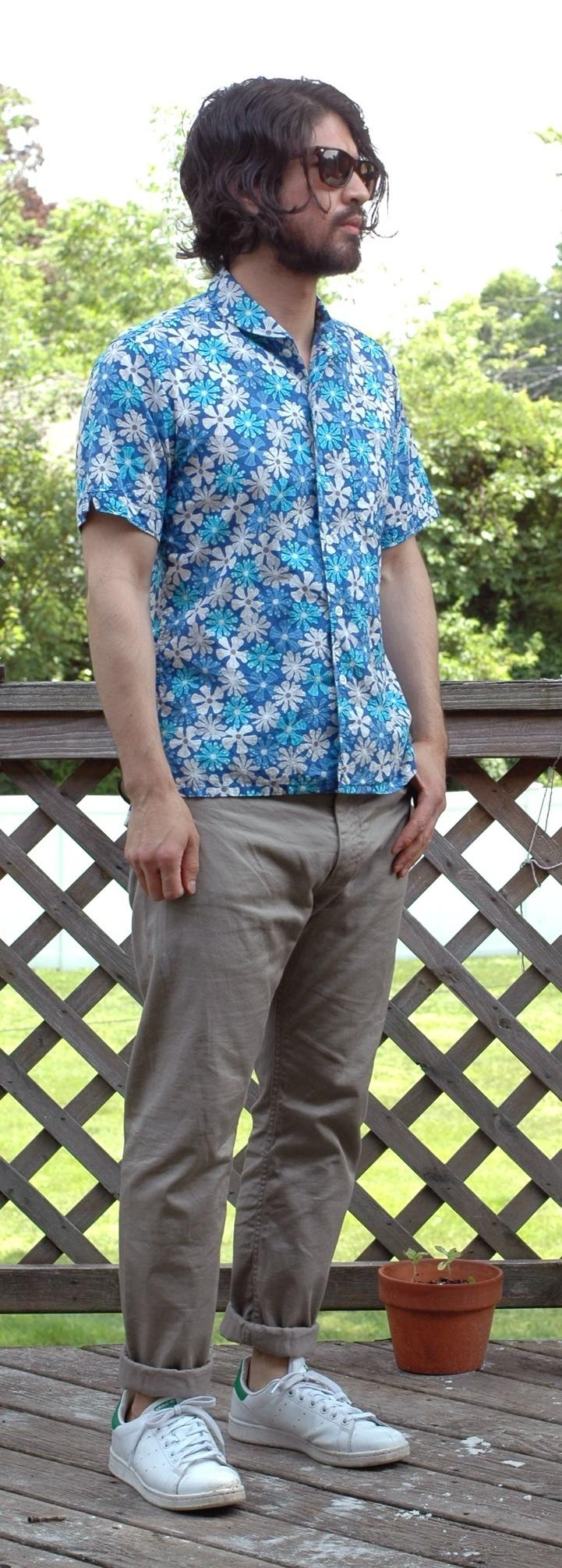 man wearing khaki chinos and floral shirt