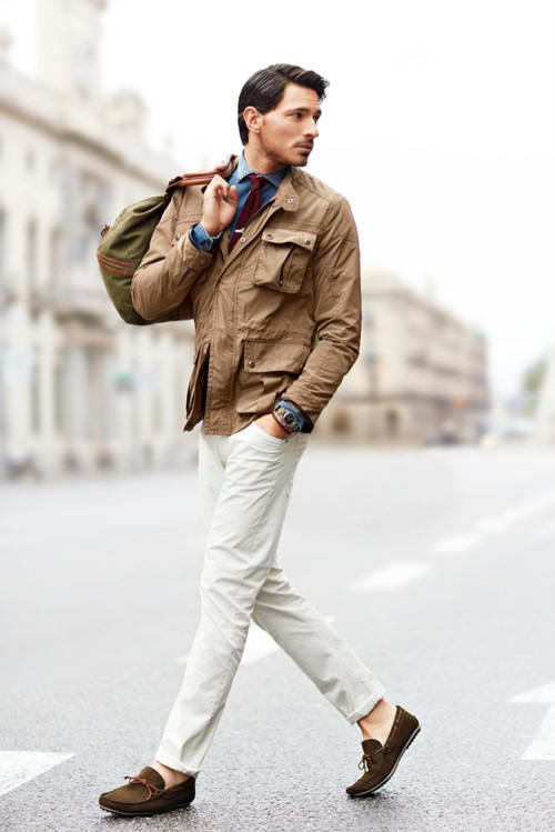 man wearing white chinos and loafers