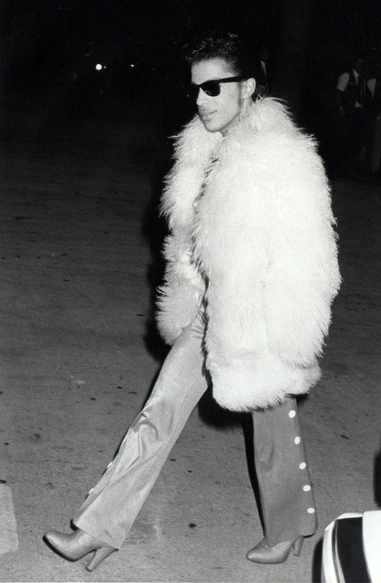 Prince wearing a fur coat