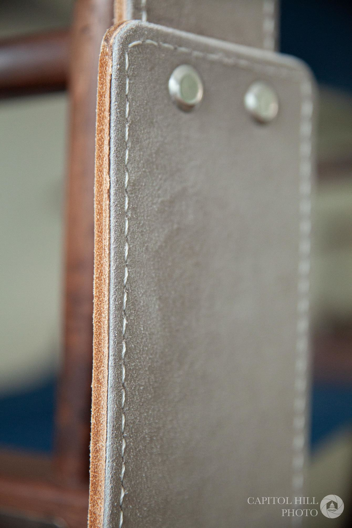 Suede lifting belt stitching