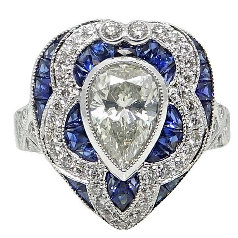 1.34 ct Pear Shaped Diamond and Sapphire Engagement Ring