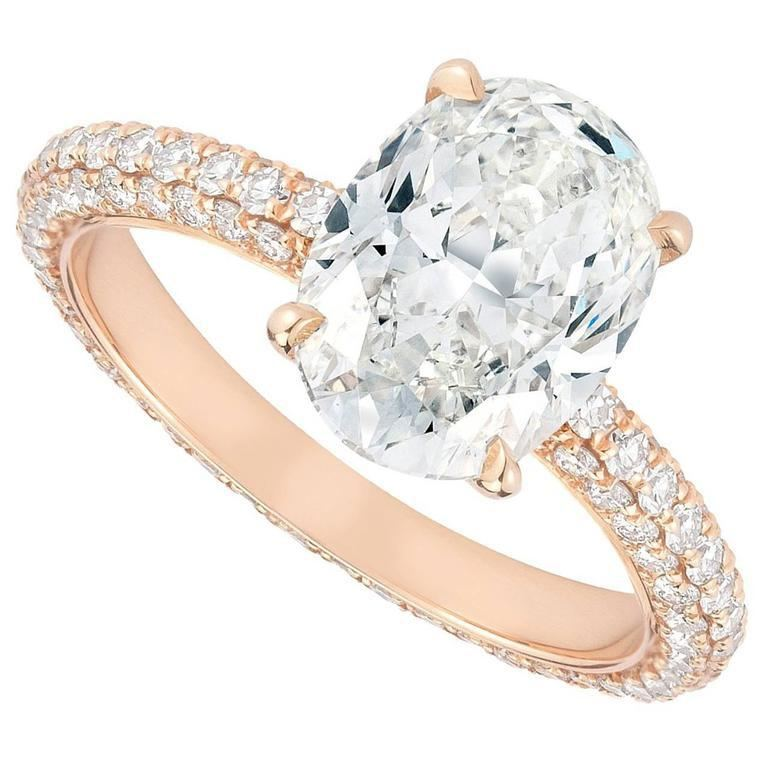 2.04 carat oval shaped diamond engagement ring with a micro- pavé band set in 18K rose gold.