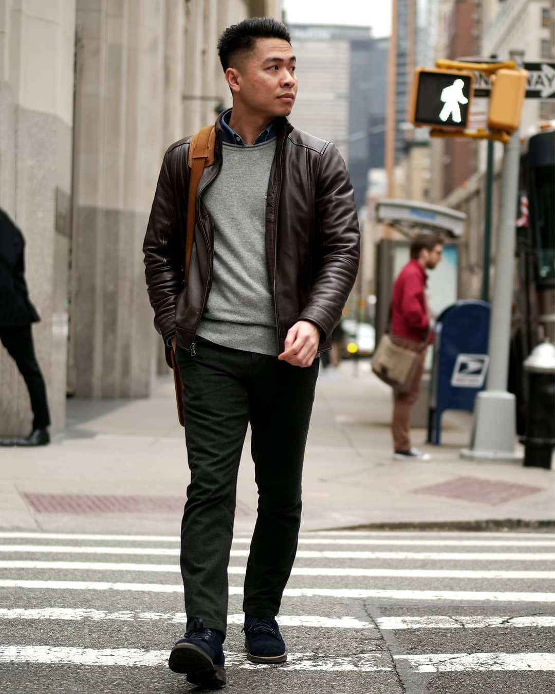 Gray sweater with leather jacket