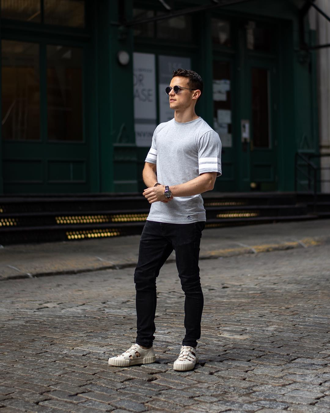 black jeans with gray sneakers