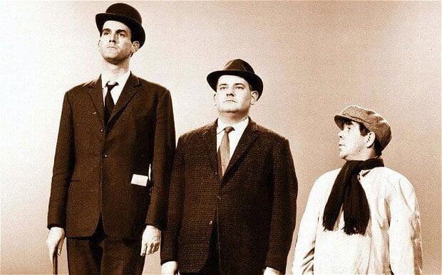 b&w of three men of varying heights