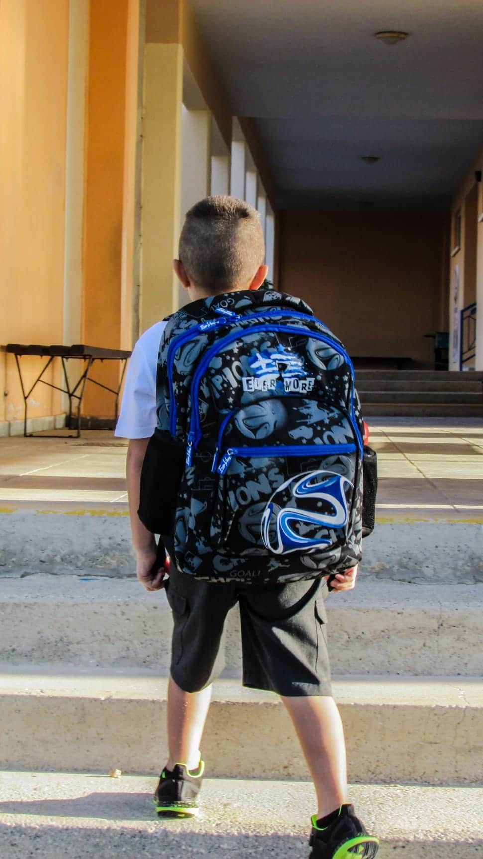 Kid with big backpack